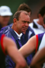 Gerard Neesham addresses his players during the break at a 1995 Ansett Cup, pre-season match.