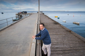 Charles Reis and the Flinders Community Association are fighting to stop demolition of the historic pier.