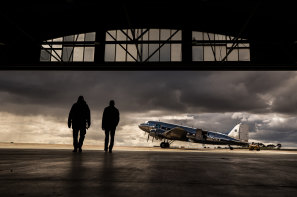 A 40-year success: Father and son at Shortstop Jet Charter's Essendon Fields Airport hangar with their vintage DC-3 airliner.