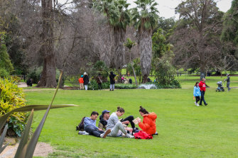 People are seen walking and having picnics at Treasury Gardens this month.