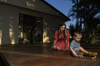 Jayne Pavic and son Spencer outside their new rental property.