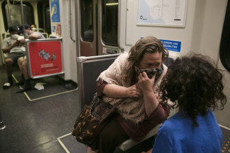 A commuter talks to her son on the train in Los Angeles on Monday.