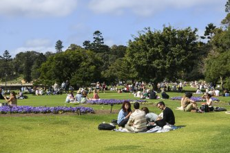 People took advantage of eased restrictions to enjoy picnics in the Royal Botanic Gardens in Sydney on Saturday.