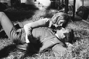 Honor Blackman as Pussy Galore and Sean Connery as James Bond filming a fight scene which develops into a love scene in Goldfinger.