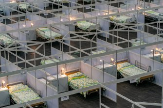 Beds are seen at a temporary field hospital set up at the Asia World Expo hall in Hong Kong in preparation for a third wave of COVID-19.