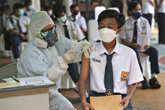A student receives the COVID-19 vaccine.