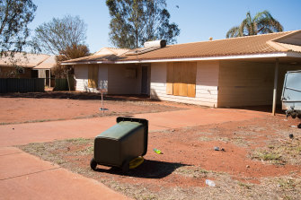 Boarded up homes outnumber occupied properties in some areas of Newman, where BHP owns many of the houses.