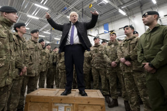 Boris Johnson speaks to British troops stationed in Estonia during a visit to the Baltic country on December 21.