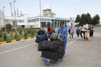 Passengers outside the main terminal at Kabul airport. Thousands of people were trying to flee the Afghan capital as the Taliban took charge of the city.