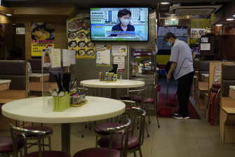 A TV in a Hong Kong restaurant broadcasts Chief Executive Carrie Lam during a press conference.