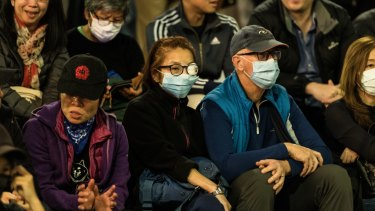 Many protesters wore masks to prevent themselves from being identified, and eye patches.