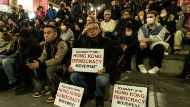 Protesters hold pro-Hong Kong signs at the 'Stand With Hong Kong' rally at Martin Place on Friday night.