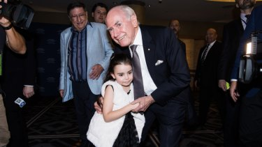 Liberal supporters in the Ballroom of the Sofitel Wentworth, for the Liberal party post election celebration. Photo shows Former Prime Minister John Howard arriving .