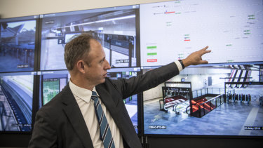 Transport Secretary Rodd Staples in the operations control centre for the metro line at Rouse Hill.