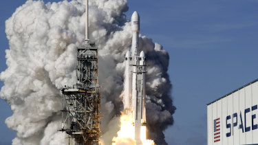 A Falcon 9 SpaceX heavy rocket lifts off from pad 39A at the Kennedy Space Center in Cape Canaveral, Florida.