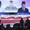 Indonesia's President Joko Widodo (left) delivers his speech as opponent Prabowo Subianto listens during the televised debate in Jakarta on Sunday night.
