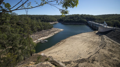 Sydney dams start to spill after a saturated six months