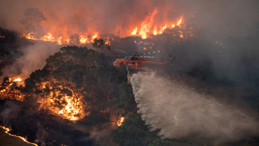 A firefighting helicopter tackling a bushfire near Bairnsdale in Victoria's East Gippsland in December 2019.
