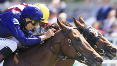 Jean Van Overmeire drives Glistening to victory in the Reisling Stakes.
