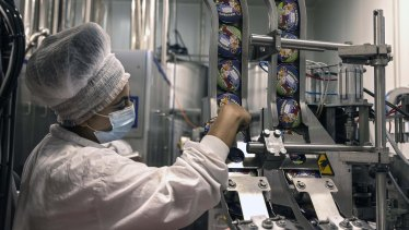 An Israeli works at the Ben & Jerry's ice-cream factory in the Be'er Tuvia Industrial area.