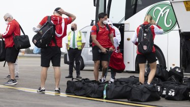 Dragons players and staff at Sydney airport during the week to board a flight to Queensland.
