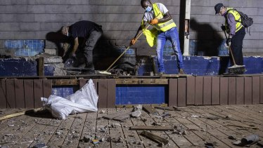 Israeli police inspect the damage at the site hit by a rocket fired by Palestinian militants from the Gaza Strip in the southern city of Ashdod, Israel.