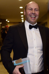 Federal Treasurer Josh Frydenberg arrives for John Howard's birthday.