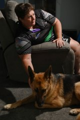 Former police officer Danielle Thorp with her service dog, Kyra.