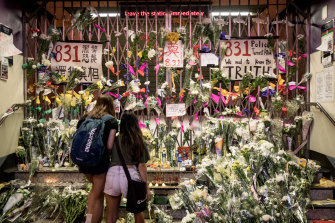 People lay flowers at a tribute wall at the entrance to Prince Edward MTR station, where some believe protesters were killed. Police and medical authorities have denied the rumours.