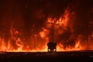 December, 2019: A fire truck in front of a huge bushfire at Orangeville.
