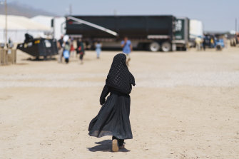 A child walks through Fort Bliss, New Mexico, where Afghans evacuated from Kabul are being housed.