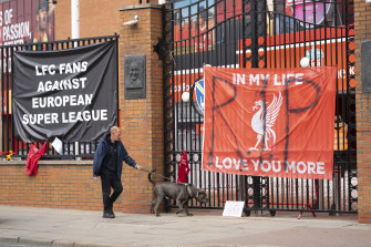 Banners outside Liverpool's Anfield Stadium after the collapse of English involvement in the proposed European Super League.