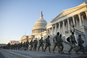 Members of the National Guard outside of the US Capitol as the House prepares to vote.
