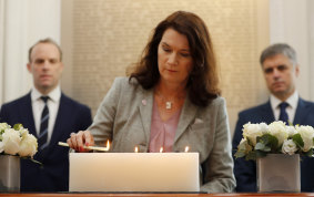"Swedish Foreign Minister Ann Linde, seen here lighting a candle in memory of the victims of the Ukrainian plane shot down in Iraq, said the Chinese ambassador's comments amounted to an ""unacceptable threat""."