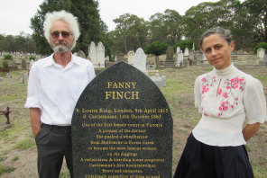 Bill Garner and his daughter Alice Garner at the grave of their ancestor Fanny Finch.
