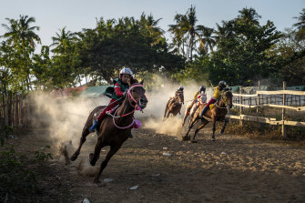 A horse race in Bima, on the Indonesian island of Sumbawa, where child jockeys are a longstanding tradition.