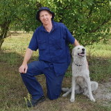 Farmer Brendon Dunn with his dog Christie.