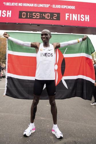 "Eliud Kipchoge celebrates his ""record"" marathon time in Vienna in 2019."