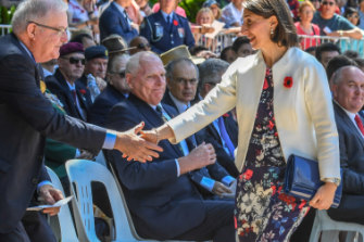 Premier Gladys Berejiklian in floral skirt with poppies.