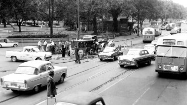Traffic jams in Elizabeth Street, Sydney on 12 December 1961, due to workmen removing tram tracks.