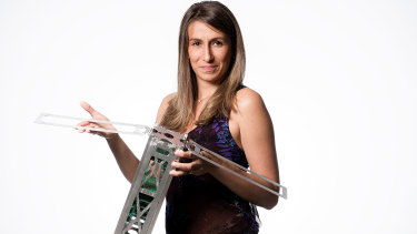 Fleet Space Technologies CEO Flavia Tata Nardini with one of the company's nano satellites.