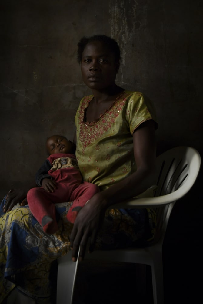 Bibisha Malu, 29, holds her daughter Cristine, who is the result of rape. She was held captive for one year and three months.