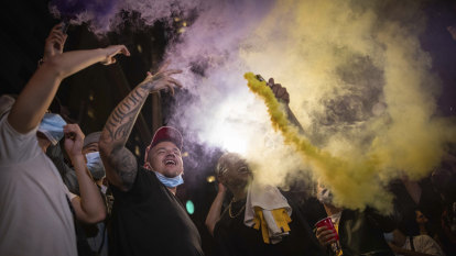 Police arrest 76 as fans, some rowdy, cheer Lakers win in LA