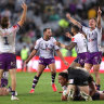 Cameron Smith and the Storm celebrate their grand final win on the whistle.