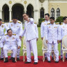 Thai Prime Minister Prayut Chan-o-cha assists his Deputy Prime Minister General Prawit Wongsuwan during a group photo after cabinet reshuffle at Government House in Bangkok last month.