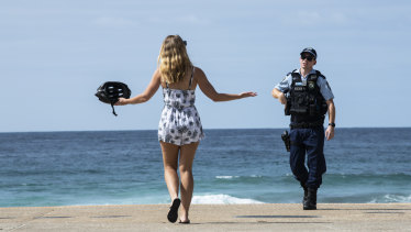 Police at Maroubra beach. After opening for a couple of hours, the beach it was once again closed on Saturday.