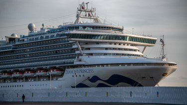The Diamond Princess cruise ship sits docked at Daikoku.