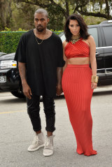 Rapper Kanye West (with Kim Kardashian West) in his Yeezy 750s, which fetch top dollar on the resale market.