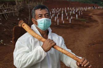 Pak Tuing, a grave digger at a public cemetery that is being expanded to accommodate rising COVID-19 deaths in Jakarta.