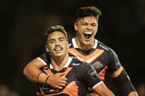 Daine Laurie and Tommy Talau celebrate a first-half try.